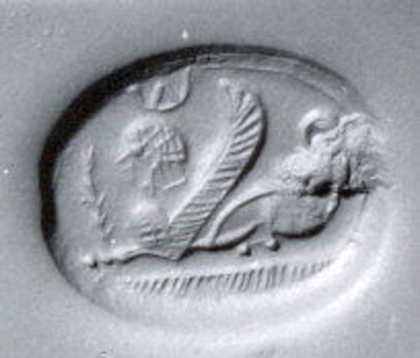 Scaraboid seal: seated sphinx wearing Egyptian-style crown