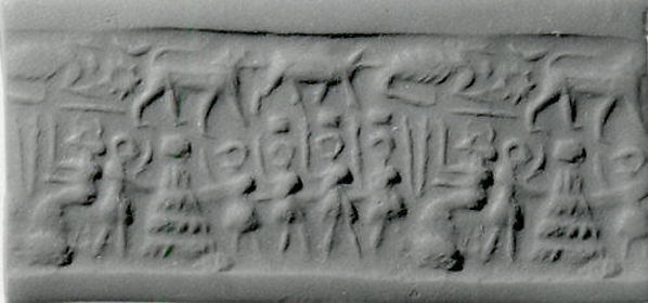 "Cylinder seal and modern impression: seated goddess before figures carrying boxes, one placed on ""altar"""