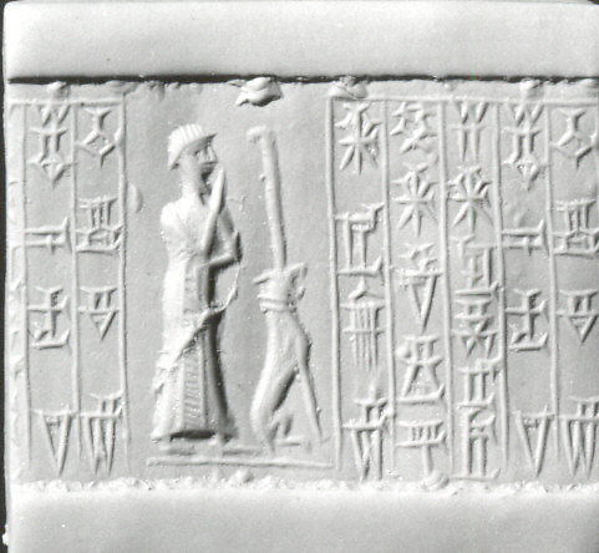 Cylinder seal: male worshiper, dog surmounted by a standard
