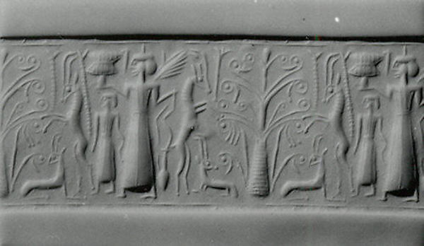 Cylinder seal: mistress of animals flanked by rampant horned animals