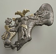 Shaft-hole axe head with bird-headed demon, boar, and dragon