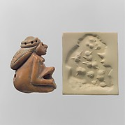 Seal amulet in the form of a seated female