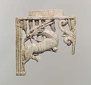 Openwork plaque with an oryx eating a plant beside a tree