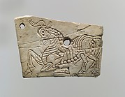 Plaque with a kneeling bull