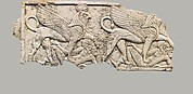 Plaque with two winged sphinxes, each trampling a fallen Asiatic