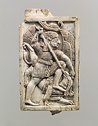 Plaque with a figure in an Egyptian-style red crown, slaying a griffin