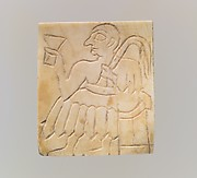 Inlay: seated male with cup and palm frond