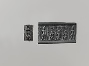 Cylinder seal and modern impression: pharaoh wearing Double Crown, kneeling figures below vultures holding shn symbols; ankh