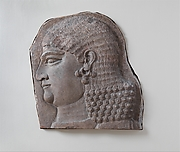 Head of a beardless royal attendant, possibly a eunuch
