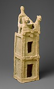 Cult vessel in the form of a tower with cylinder seal impressions near the top
