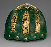Helmet with divine figures beneath a bird with outstretched wings