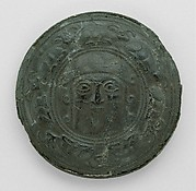 "Roundel with head of a ""hero"" surrounded by caprids"