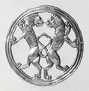 Ornament with back-to-back lions