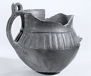 "Handled ""palace ware"" pot"