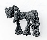 Plaque in the form of a striding lion