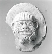 Plaque with face of the demon Humbaba