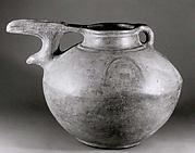 Bridge-spouted pitcher