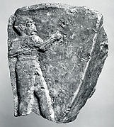 Fragment of a trough with a nude male figure in relief