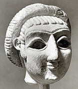 Female head with elaborate hairstyle