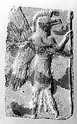 Molded plaque: eagle-headed apkallu