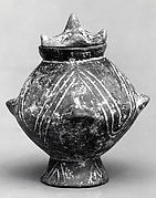Vessel with a lid and incised decoration