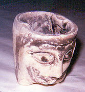 Bowl with human head