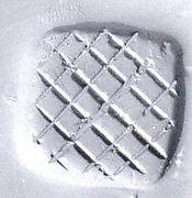 Loop (?) handled rectangular stamping device