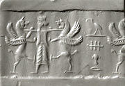 Cylinder seal: king holding two lion griffins at bay