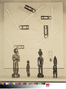 Untitled [Filipino, Easter Island, Indonesian, and Congolese sculptures in front of an unidentied painting by Morton Schamberg(?)]