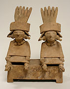 Two Ceramic Figures Seated on a Bench