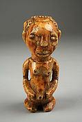 Pendant: Seated Female Figure