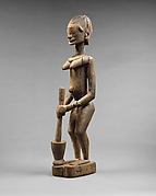 Female Figure with Mortar and Pestle