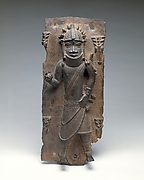 Plaque: Titleholder with Calabash Rattle