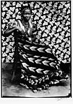 Untitled [Seated Woman with Chevron Print Dress]