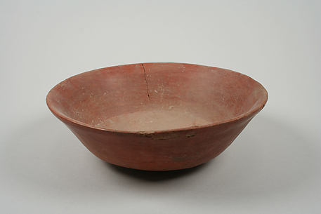 Undecorated painted bowl with flaring sides