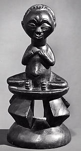 Female Figure: Seated on Stool