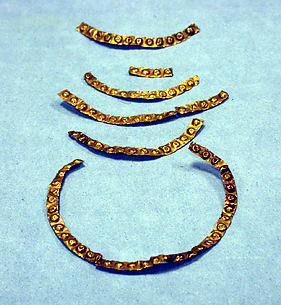 Seven Hammered Gold Strips