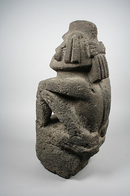 Seated Male Deity (?)