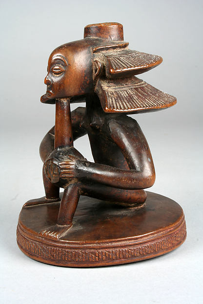 Headrest Base: Seated Female Figure