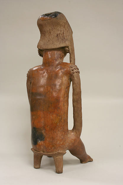 Male Figure on Stool