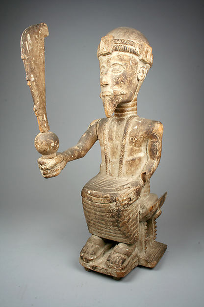 Figure: Seated Male With Sword