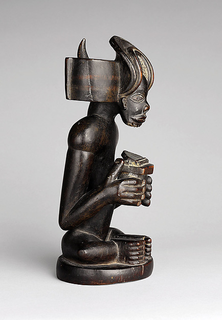 Commemorative figure of a chief playing a sanza (thumb piano)