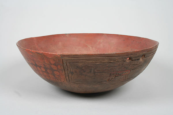 Incised bowl with felines