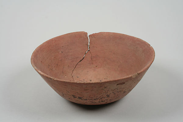 Undecorated painted bowl with flared sides