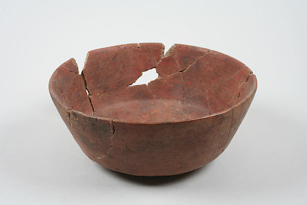Undecorated painted bowl with straight sides