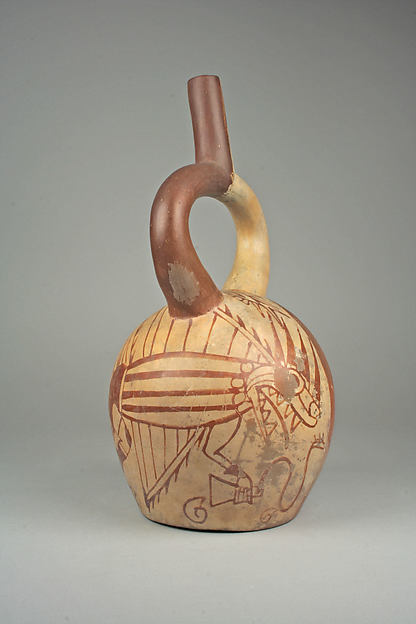 Stirrup spout bottle with fish demon and tumi