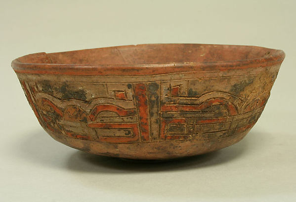 Incised Painted Bowl with Feline Faces