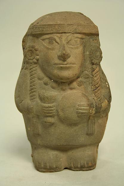 Standing Ceramic Figure Holding Disk