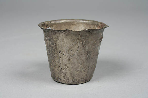 Beaker with embossed plants