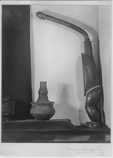 Untitled (Central African Ngbaka bow-harp, Kuba cammwood powder container and Kongo clay vessel)